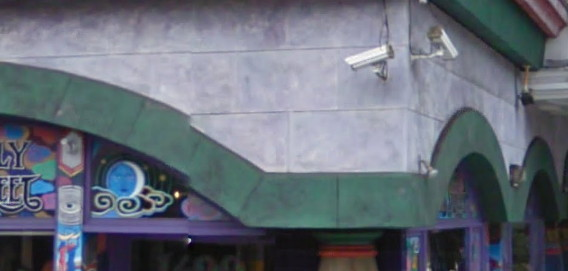 surveillance cameras on a colourful, Sixties-style decorated store on Haight Street