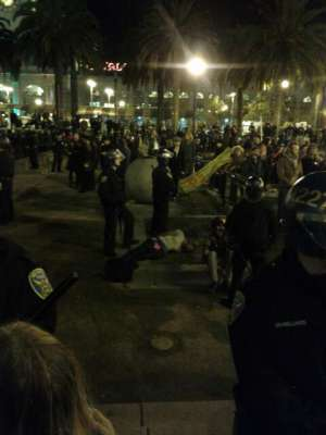 SFPD cops stand around impassively as Chris Jones is lying on the ground shaking
