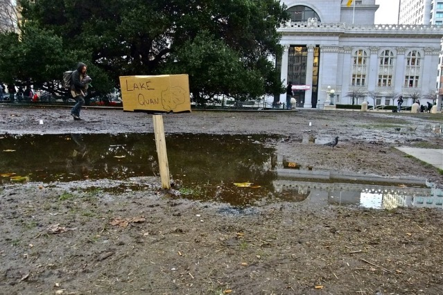 muddy area on Oscar Grant Plaza with a small sign that says Lake Quan